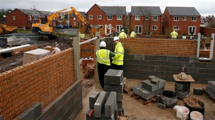 Then Chancellor, George Osborne, visits a housing development earlier this year.