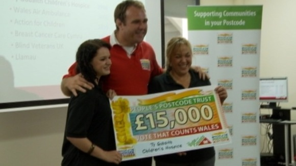 Scott Quinnell with employees from Ty Bobaith