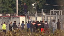 Migrants wait at the border.
