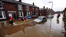 File photo from December, 2015, shows flooded homes in Carlisle