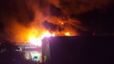 Huge fire rips through caravan centre in Somerset