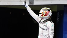 Lewis Hamilton celebrates securing pole position in Malaysia.