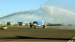 Fire engines use their water canons to provide a salute as the last BMI flight lands at Heathrow Airpor