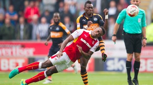 Newcastle United's Christian Atsu is challenged by Rotherham United's Darnell Fisher.