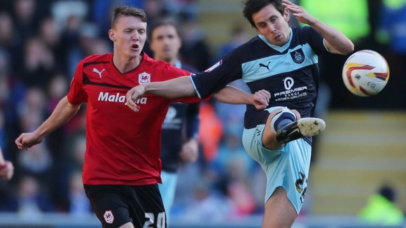 Cardiff City's Joe Mason and Burnley's Brian Stock battle for the ball during the npower Championship match at Cardiff City Stadium