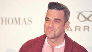 Take That star Robbie Williams helped the X Factor acts out with advice.