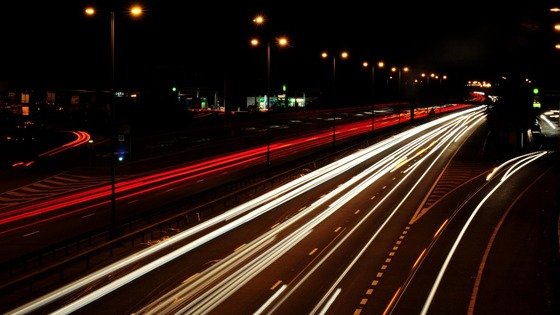 Lighting on motorways, trunk roads and city streets has been turned off or dimmed at night in order to save money and cut carbon emissions.