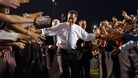 U.S. Republican Presidential nominee Mitt Romney leaves a campaign rally through a corridor of supporters in Land O&#x27;Lakes on Saturday.