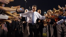 U.S. Republican Presidential nominee Mitt Romney leaves a campaign rally through a corridor of supporters in Land O'Lakes on Saturday.