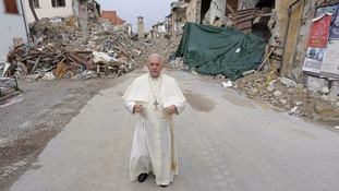 Pope Francis makes surprise visit to quake-stricken Italian town