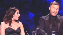 Gary Barlow and Tulisa Contostavlos with the Talent Show award for the The X Factor, backstage at the National Television Awards 2012.