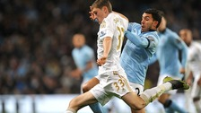 Swansea City's Ben Davies and Manchester City's Carlos Tevez