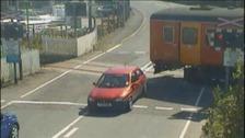 train nearly hits car