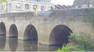 Stolen car damages historic Town Bridge