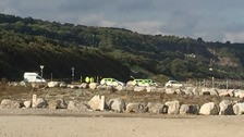 police cars at Llanddulas beach