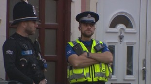 officers outside house in Cardiff