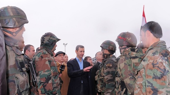 President Assad has visited the Babr Amr district of Homs.