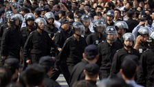 Riot police marched in Ningbo.