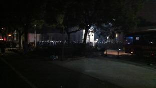 Ranks of riot police.