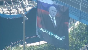 The banner showed Putin with the word 'Peacemaker'.