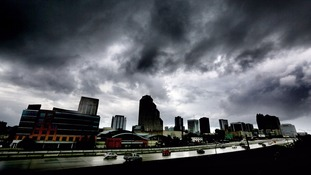 The first outer bands of rain pass over downtown Orlando, Florida.