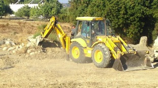 A digger was brought onto the site this morning to scrape away mounds of earth