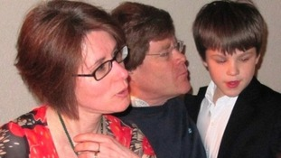 Missing schoolboy Pierre Barnes with his parents