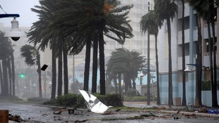 Debris flies through the air as Matthew reaches Daytona Beach in Florida