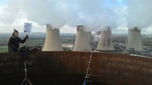 Protesters are tweeting pictures of themselves at the top of the chimney stacks