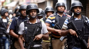 Security personnel conducSecurity personnel conduct a police operation on the outskirts of Dhaka, Bangladesh, in July