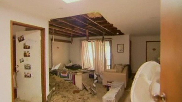 Simon and Caroline Yap&#x27;s damaged home