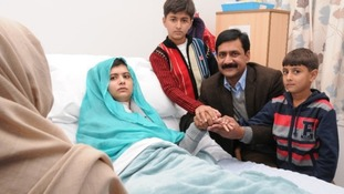 Malala Yousufzai with her family at her bedside