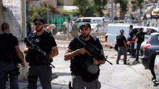 Israeli police stand guard at the scene of the shooting.