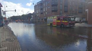 Burst main causes flooding while hundreds left without water