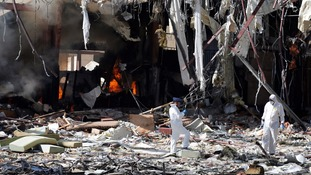 Forensic experts investigate the scene at the community hall where Saudi-led warplanes struck a funeral in Sanaa, the capital of Yemen.