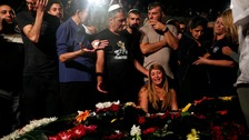 Relatives and friends mourn over the grave of Israeli policeman Yosef Kirma who was killed by a Palestinian assailant.