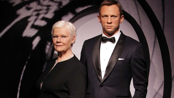 Wax works of Daniel Craig and Judi Dench