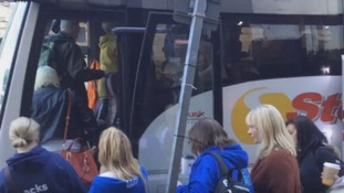 Protestors board a coach in Huddersfield