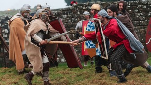 Roman Soldiers taking part in a re-enactment battle with the Barbarians at Hadrian's Wall.