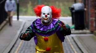 A person dressed as a clown.