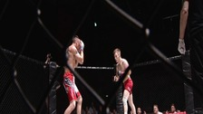 Two fighters in the caged octagon
