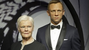 Wax works of Dame Judi Dench and Daniel Craig