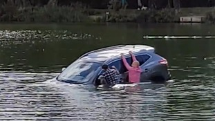 Brave passers-by jump into lake to rescue pensioner from sinking car