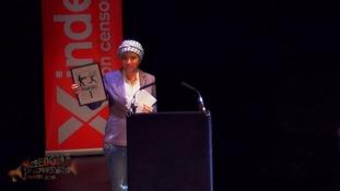 Zaina Erhaim collects an award.