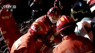 Three-year-old girl rescued from rubble after 15 hours in her dead parents' arms