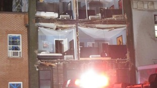 Close up of building facade collapse on 8th Avenue between 14th and 15th Street