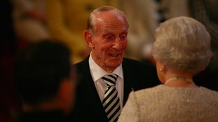 Guthrie receiving an MBE from The Queen in 2010