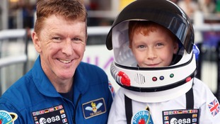 Tim Peake with a schoolboy