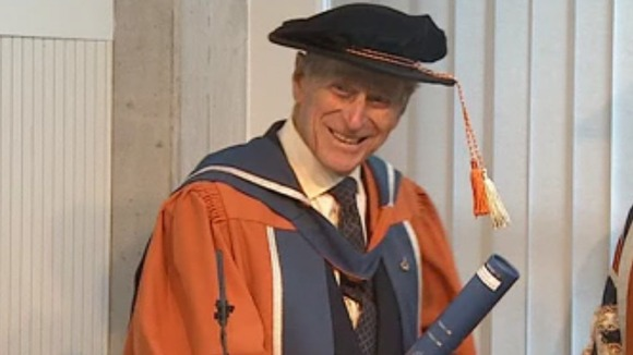 The Duke jokes as he receives his doctorate