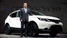 Nissan chief executive Carlos Ghosn with a Qashqai model